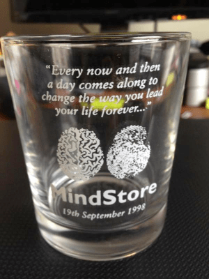 mindstore glass with quote and logo